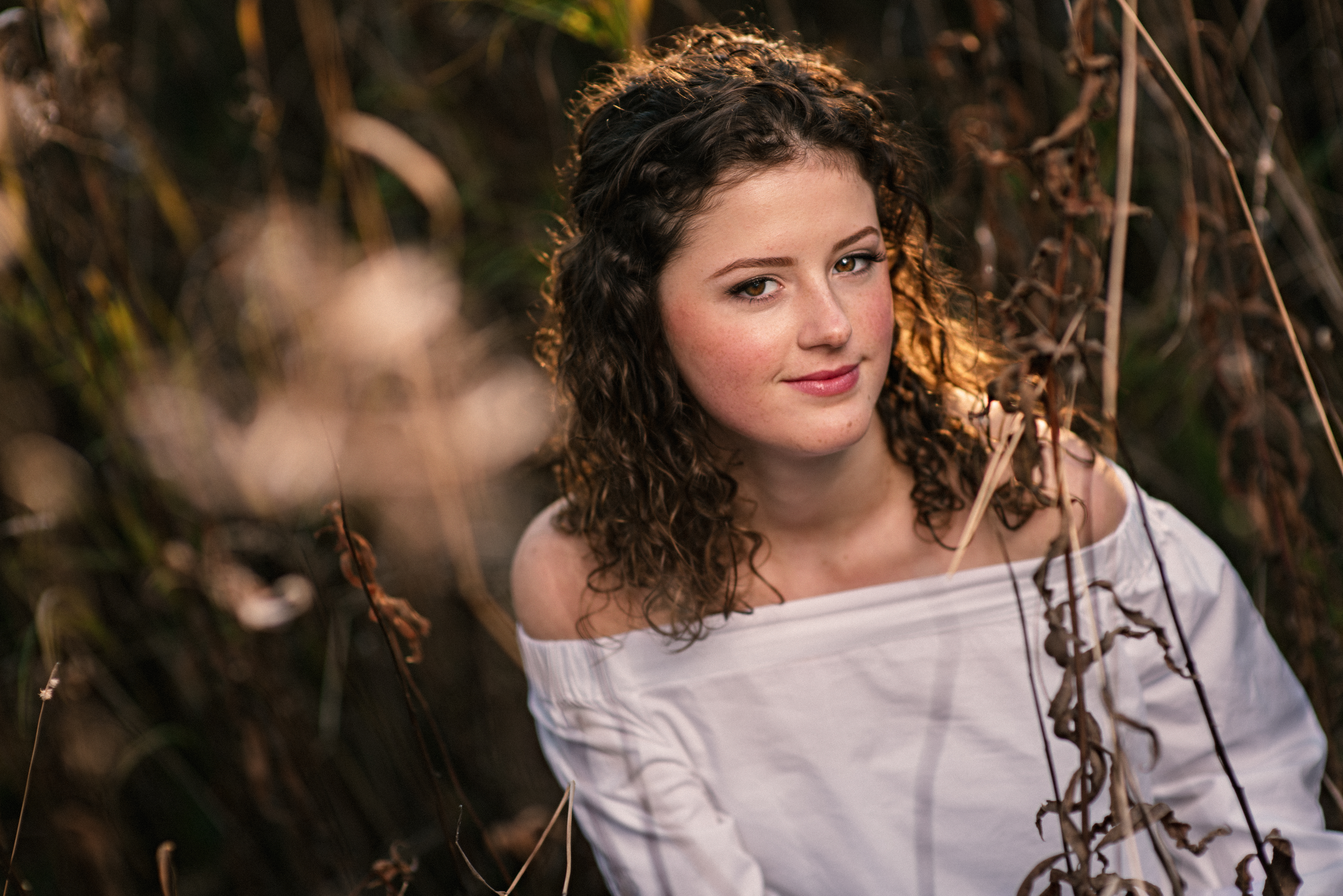 anchorage senior pictures field in the fall curly hair brunette white blouse
